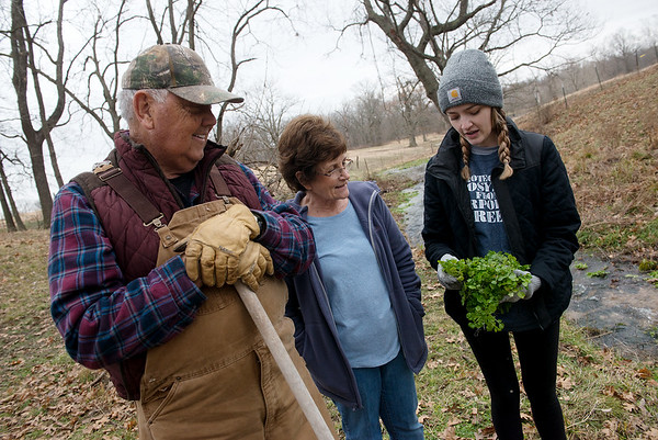 Clarence, Joan and Katie Martin look over plants found in Cedar Creek on Thursday.<br /> Globe | Roger Nomer