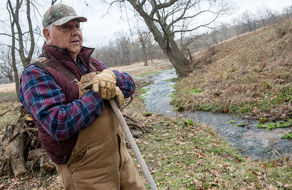 Clarence Martin looks over Cedar Creek at his family's farm in Newton County on Thursday.<br /> Globe | Roger Nomer