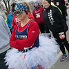 Anna Simpson, Webb City, tries to stay warm at the start of the Chilly 5K on Tuesday at Joplin Memorial Hall.<br /> Globe | Roger Nomer