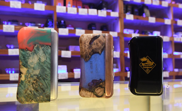 Upscale vaprizors sit on a display case at Vapor Maven on Friday.<br /> Globe | Laurie Sisk