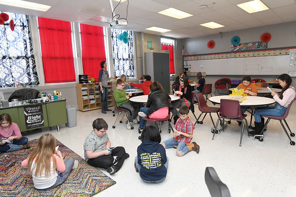 Students work on a project during Miranda Hembree's gifted child class on Friday at the Memorial Education Center. The building turns 100 on Sunday.<br /> Globe | Laurie Sisk