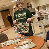 Trey Erway, an East Newton High sophomore, helps unpack wheelchair bags students made for veterans and distributed during a visit to the Missouri Veterans Home in Mt. Vernon on Wednesday.<br /> Globe | Roger Nomer