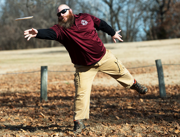 Globe/Roger Nomer<br /> James Childers, Loma Linda, plays disc golf on Wednesday at McClelland Park.
