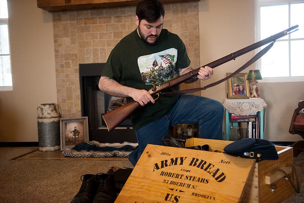 David Carnine talks about a rifle used for Civil War re-enactments during an interview on Thursday in Carl Junction.<br /> Globe | Roger Nomer