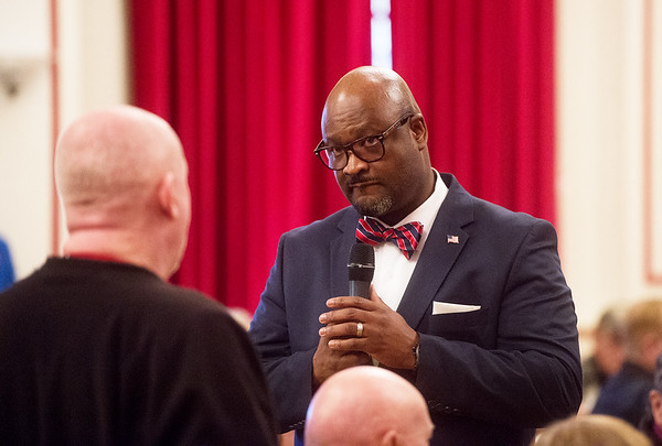 Kelvin Parks, director of Veterans Health Care System of the Ozarks, listens to a question during a town hall meeting on Monday in Fayetteville.<br /> Globe | Roger Nomer