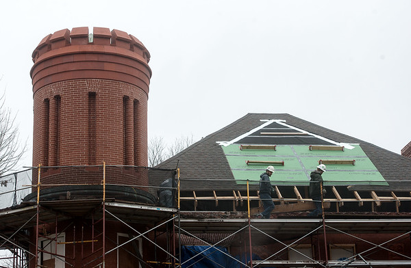 Restoration continues on the roof of the historic Schifferdecker House in Joplin on Wednesday afternoon. The roof is being restored to match its original slate design.<br /> Globe | Roger Nomer