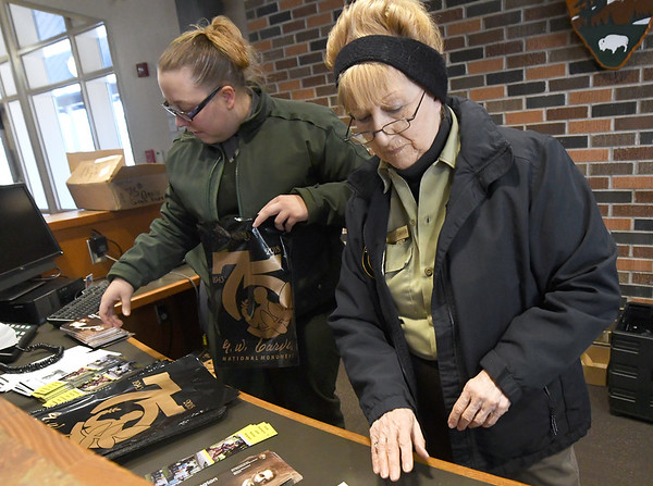 From the left: At George Washington Carver National Monument, Park Guide Sarah Martin and volunteer Rose Carter prepare information packets on Thursday in preparation for a Friday program on George Washigton Carver's life at Granby Elementary.<br /> Globe | Laurie Sisk