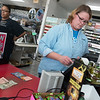 Globe/Roger Nomer<br /> Jeanna Garrett rings up a Powerball ticket for a customer on Friday at Doc's Stop in Joplin.