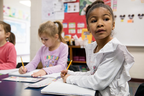 Luna Zimmerhakl, left, and Amaya Simon work on their handwriting journals during kindergarten class at Cecil Floyd on Thursday.<br /> Globe | Roger Nomer