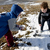 From the left: Alex Richardson, 5 and Zoey Black, 2, make tiny snowballs from one of the few remaining patches of snow on Friday at Parr Hill Park.<br /> Globe | Laurie Sisk