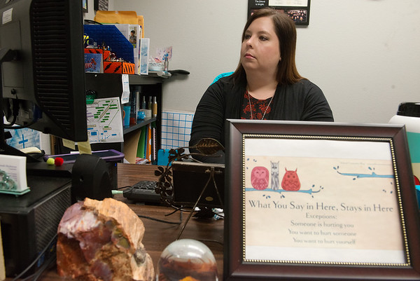 Sarah Hethmon works as a counselor at Carthage Intermediate Center on Friday.<br /> Globe | Roger Nomer