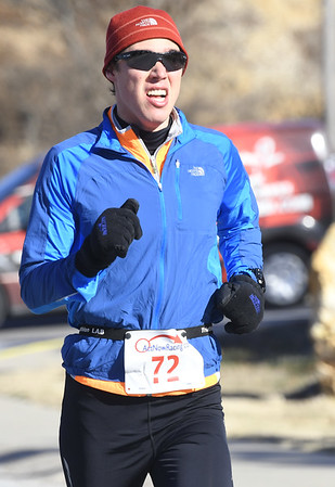 Michael Huffaker nears the finish line for a second place finish in the Joplin Family YMCA's Chilly 5k on Monday morning at the YMCA. <br /> Globe   Laurie Sisk