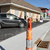 Traffic cones sit outside the New to Me Consignment store as road construction continues on Wednesday afternoon near 20th and Main streets.<br /> Globe | Lairie Sisk