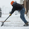 Globe/Roger Nomer<br /> Fermin Benhumea clears a sidewalk in downtown Webb City on Monday.