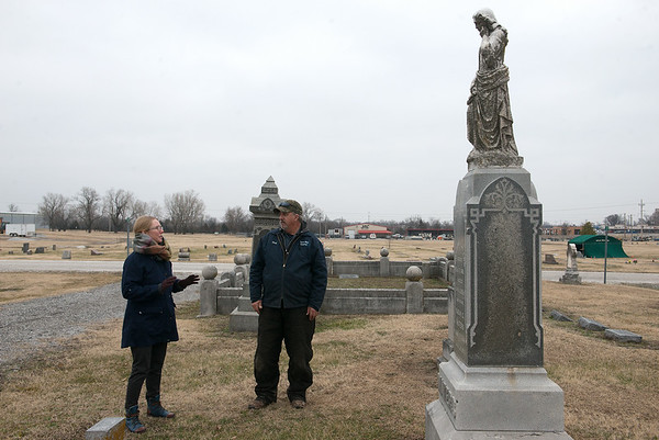 Jill Sulivan and Chris Ferguson talk about the history of Fairview Cemetery on Wednesday afternoon.<br /> Globe | Roger Nomer