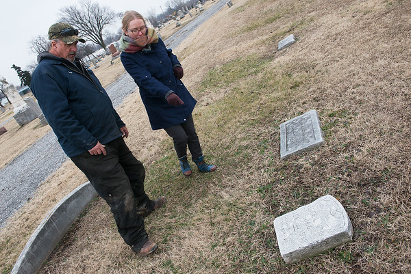 Jill Sulivan and Chris Ferguson talk about the history of Fairview Cemetery and tombstones of Joplin volunteer firefighters on Wednesday afternoon.<br /> Globe | Roger Nomer