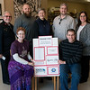 Globe/Roger Nomer<br /> On Thursday, Heather and Jeff Grills, of Phoenix Fired Art, present checks from the Empy Bowls fundraiser to (back row from left) Maj. Douglas Stearns, Joplin Salvation Army, Rodney Rambo, executive director of Crosslines, Eileen Nichols, Webb City Farmers Market, Travis Hurley, director of advancement at Watered Gardens, and Stephanie Denham, nutrition programs director for the Area Agency on Aging. The fundraiser sold 677 bowls, and with the proceeds from bowls and a raffle raised $17,017 to be distributed amont the five agencies.
