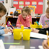 Kindergarten students work on handwriting journals at Cecil Floyd Elementary on Thursday.<br /> Globe | Roger Nomer