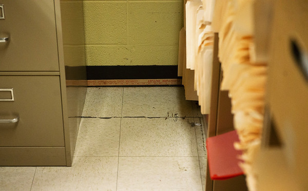 Cracks have formed in the floor of the Jasper County Courthouse under the weight of printed records.<br /> Globe   Roger Nomer