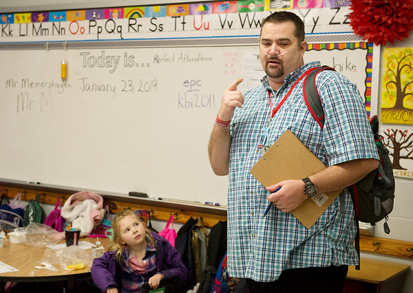 David Meinershagen explains his lung disease and need for oxygen tubes to first graders at Webster Elementary in Webb City on Wednesday.<br /> Globe | Roger Nomer