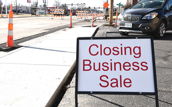 A closing for business sign sits outside the New to Me Consignment store as road construction continues on Wednesday afternoon near 20th and Main streets.<br /> Globe | Lairie Sisk