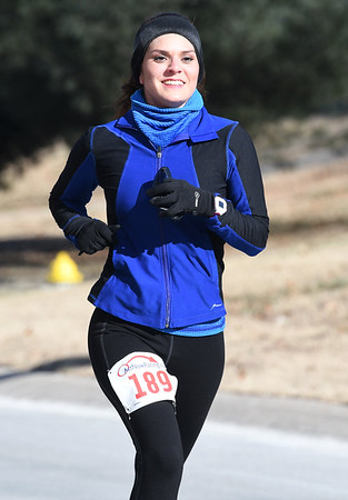 Janette Brooks smiles as she nears the finish line during the Joplin Family YMCA's Chilly 5k on Monday morning at the YMCA. Brooks finished first among all female runners.<br /> Globe | Laurie Sisk