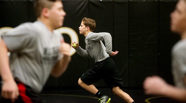 Cayden Auch, freshman, runs sprints during practice on Wednesday at Neosho High.<br /> Globe | Roger Nomer