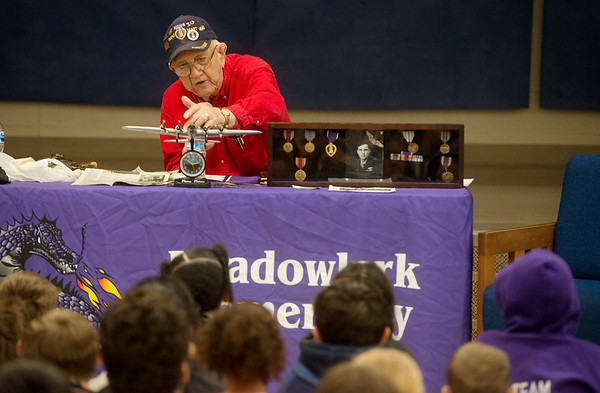 Homer Cole shares his experiences in WWII with students at Meadowlark Elementary on Thursday.<br /> Globe | Roger Nomer