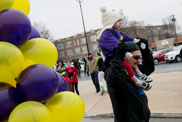 Brian Fonville gives his nephew AJ a piggyback ride across the finish line of the Chilly Fun Run on Tuesday at Joplin Memorial Hall.<br /> Globe | Roger Nomer