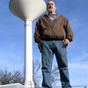 Goodman Mayor Greg Richmond stands beneath a water tower near Goodman City Hall on Friday. Richmond, like other Goodman residents, has water quality concerns about a proposed chicken plant outside the city limits.<br /> Globe | Laurie Sisk