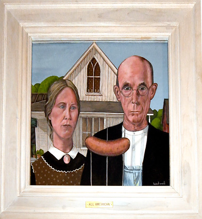 "Diane Cantrell's whimsical piece, ""All-American,"" hangs on a wall at Instant Karma on Wednesday.<br /> Globe 