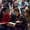Globe/Roger Nomer<br /> (from left) Thomas Jefferson freshmen India Robinson, Victoria Henson-Miyauchi and Kennedy Schwartz look at a Thomas Aquinas book on Wednesday.