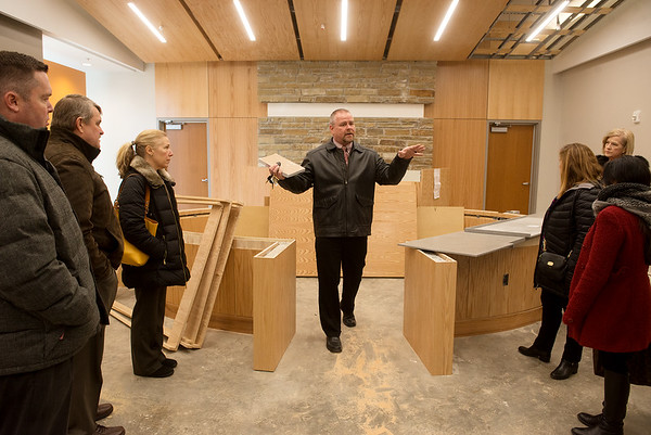 Erik Theis, court administrator, gives a group of CASA volunteers a tour of the new Juvenile Services Center on Wednesday.<br /> Globe | Roger Nomer