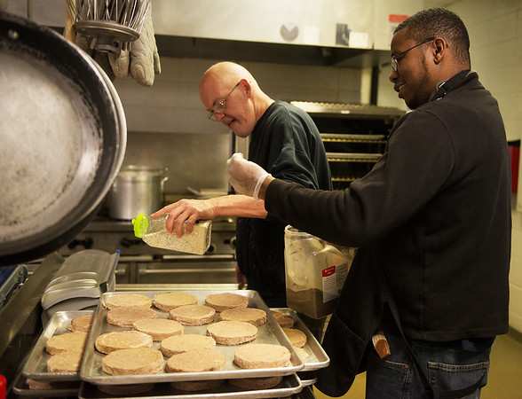 Gregory Oliver, a Missouri Southern senior from Carthage, right, helps Rusty Long prepare lunch at the Joplin Salvation Army during Monday's Martin Luther King Jr. Day of Service.<br /> Globe | Roger Nomer