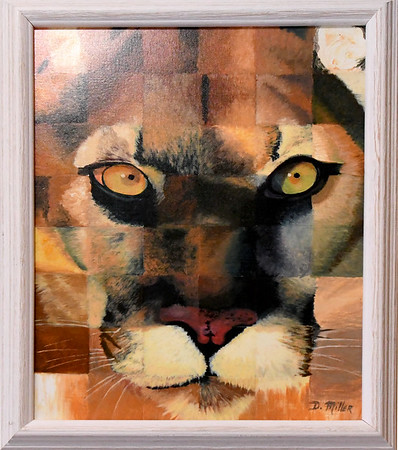 """Artists Dustin Miller's """"Wildcat"""" hangs on a wall at the Joplin Avenue Coffee Company on Wednesday.<br /> Globe   Laurie Sisk"""