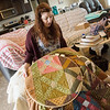 Loren Carnine talks about a quilt she is working on during an interview on Thursday in Carl Junction.<br /> Globe | Roger Nomer