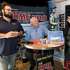 From the left: Coby Cherry and Rod Haynes, of Home Pro, assist Arden Kerr as he inquires about solar panel systems during the 26th Annual Joplin Area Chamber of Commerce Business EXPO at Downstream Casino on Tuesday.<br /> Globe | Laurie Sisk