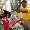 Keron Kowles, a Missouri Southern senior from the Bahamas, operates a heat press as he helps students make custom pop sockets on Thursday at MSSU.<br /> Globe | Roger Nomer