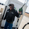 Globe/Roger Nomer<br /> Kerry Stanbery, an inspector at CFI, fuels up a truck on Friday afternoon.