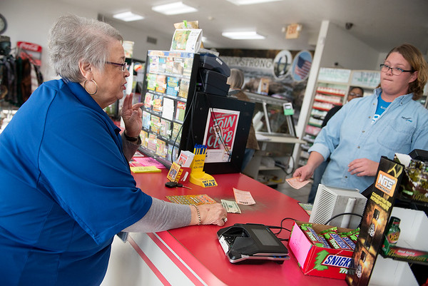 Globe/Roger Nomer<br /> Judy Jennings, Joplin, buys a Powerball ticket from Jeanna Garrett at Doc's Stop on Friday in Joplin.