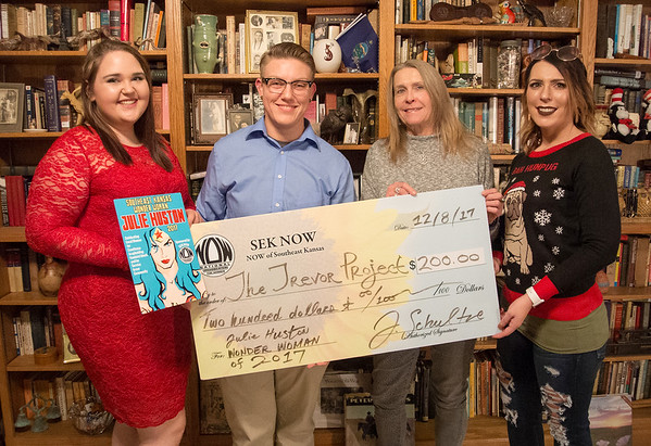 Courtesy Photo<br /> Pictured left to right: Megan Yocum, Wonder Woman Julie Huston, SEK NOW Co-Coordinators Lyn Schultze and Ashley Caldwell at the SEK NOW award presentation on Dec. 8, 2017.