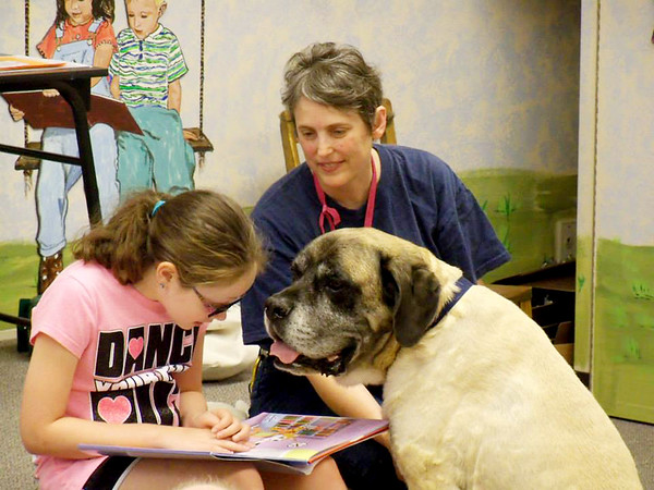 Courtesy Debbie Markman<br /> TSKC Member Debbe Markman & Pura Vida reading at Joplin's Children's Library. Debbie Markman, as a member of the Tri-State Kennel Club, does more than instruct classes — she also takes time to team dogs with children for some fun and educational moments.