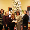 Courtesy Photo<br /> (from left) Tara Horinek, Courtney Barnard, Julie Moore (Arvest), Annette Thurston and Shirley Hylton with Ronald McDonald House present and accept a check for $214.64 from Arvest Bank to Ronald McDonald House of the Four States on Wednesday. The money was raised by associates at the bank as part of their Jeans Day fundraiser.
