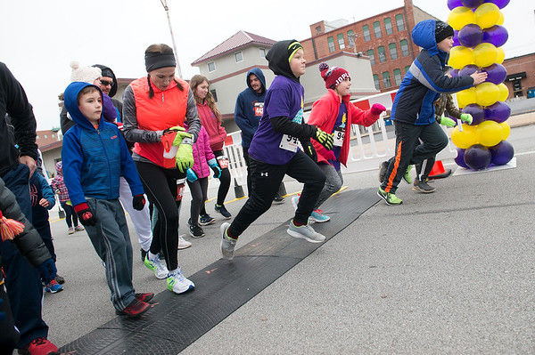 Runners start the Chilly Fun Run on Tuesday at Joplin Memorial Hall.<br /> Globe | Roger Nomer