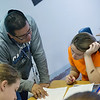 Globe/Roger Nomer<br /> Larry Brooks works with Tasha Schrader, eighth grade, on a Spanish assignment on Tuesday at Carthage Junior High School.