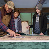Clarence, Joan and Katie Martin talk about a map of land that would be affected by a proposed reservoir during an interview at their home on Thursday.<br /> Globe | Roger Nomer