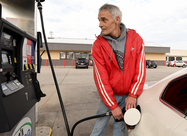 Jim Ralston fills his car with gas on Tuesday afternoon at Doc's Stop on East 32nd street. Missouri lawmakers are mulling an additional tax on gas to repair roads.<br /> Globe | Laurie Sisk