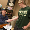 Veteran Orville Choate shakes hands with Trey Erway, East Newton sophomore, during a visit to the Missouri Veterans Home in Mt. Vernon on Wednesday.<br /> Globe | Roger Nomer