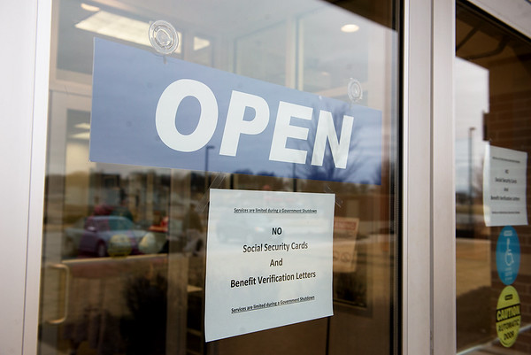 Globe/Roger Nomer<br /> A sign announces the limitation of services at the social security office in Joplin on Monday.