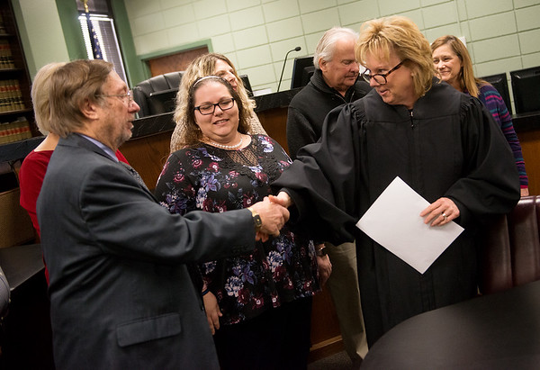 Judge Gayle Crane congratulates Larry Myers after he is sworn in as a CASA volunteer on Wednesday at the Jasper County Courthouse in Joplin.<br /> Globe | Roger Nomer
